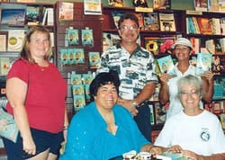 "Several co-workers and friends join Mary at her first booksigning for ""All Keyed Up,"" one of her romance novels. Several co-workers and friends helped make her first booksigning for All Keyed Up a success in the Upper Keys in July 2004. Pictured  (l-r) are Lori, Paul, Susan and Dea."
