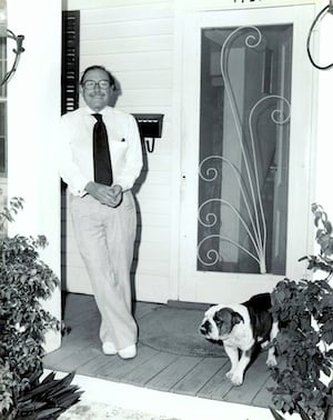 Tennessee William standing on the front porch of his home at 1431 Duncan Street, Key West with one of his dogs. From the Ida Woodward Barron Collection/Monroe County Public Library