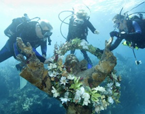In 2010, in celebration of the 50th anniversary of John Pennekamp Coral Reef State Park, a commemorative wreath was placed on the statue.