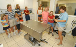 Visitors tour the Turtle Hospital and are shown the center, an oxygen delivery system used by veterinarians when performing surgery on sea turtles. Photos by Andy Newman/Florida Keys News Bureau