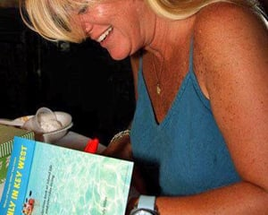 "Miles signing her book, ""Only in Key West.""  In her many books, Miles muses about the ordinary, the bittersweet and the oddly Key West with witty simplicity"